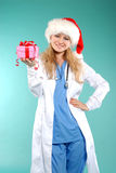Doktor - christmas. Doctor the woman in a uniform with a smile Stock Images