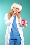 Doktor - christmas. Doctor the woman in a uniform with a smile Royalty Free Stock Photo