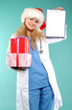 Doktor - christmas. Doctor the woman in a uniform with a smile Royalty Free Stock Photography