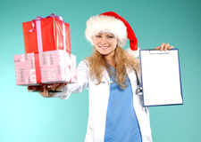 Doktor - christmas. Doctor the woman in a uniform with a smile Stock Photo
