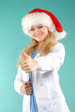 Doktor - christmas. Doctor the woman in a uniform with a smile Stock Photography