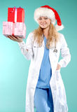 Doktor - christmas. Doctor the woman in a uniform with a smile Royalty Free Stock Image