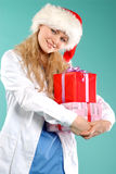 Doktor - christmas. Doctor the woman in a uniform with a smile Stock Image