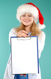 Doktor - christmas. Doctor the woman in a uniform with a smile Stock Photos
