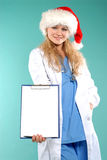 Doktor - christmas. Doctor the woman in a uniform with a smile Royalty Free Stock Images
