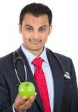 Doktor, der Apfel hält stockbilder