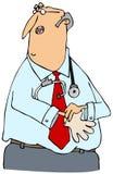 Doktor, der auf Handschuhe sich setzt Stockfotografie