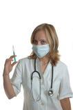 Doktor der jungen Frau mit Spritze Stockfotos