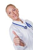 Doktor, der sich Daumen zeigt Lizenzfreie Stockfotos
