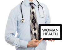 Doktor, der Tablette - Frauengesundheit hält lizenzfreie stockfotografie