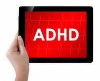 Doktor, der Tablette mit ADHD-Text zeigt Stockfotos