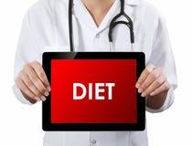 Doktor, der Tablette mit DIÄT-Text zeigt Lizenzfreie Stockbilder