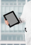 Doktor with a digital tablet Stock Photos