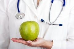 Doktor And Green Apple Arkivbilder
