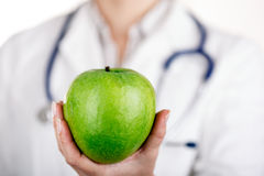Doktor And Green Apple Arkivfoton