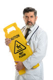 Doktor Holding Caution Sign Lizenzfreie Stockbilder