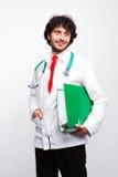 Doktor med gröna mappar Royaltyfria Bilder
