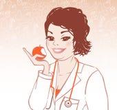 Doktor mit Apfel Lizenzfreies Stockfoto