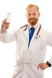 Doktor mit einer Flasche oder Pillen lizenzfreies stockfoto