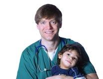 Doktor mit kleinem Patienten Stockbilder
