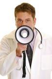 Doktor mit Megaphon stockfotos