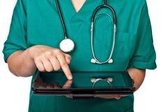 Doktor mit Tablette Stockbild