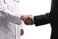 Doktor och en patient Arkivbild