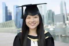 doktorand- lycklig lady för asiat Arkivfoto