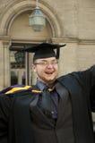 doktorand- lyckligt Arkivbild