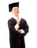 Doktorand- se för hög man och peka uppåt Fotografering för Bildbyråer