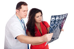 Doktoren, die Berechnungs- Tomographie (CT, deuten) Stockbilder