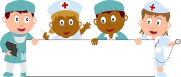 Doktoren, Krankenschwestern und Fahne Stockfotografie