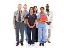 Doktorer: Gladlynt grupp av läkare och sjuksköterskor arkivbild