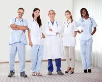 doktorer grupperar lyckligt lyckat royaltyfria bilder