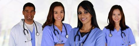 Doktorer och sjuksköterska arkivfoto