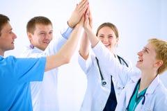 Doktorer och sjuksköterskor i stapla för medicinskt lag royaltyfria foton