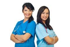 doktorer team två kvinnor Arkivfoton