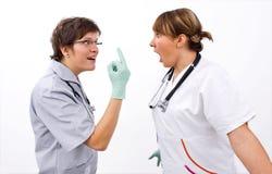 doktorer vänder mot till Royaltyfri Bild