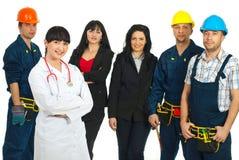 Doktorfrau vor verschiedenen Leuten Lizenzfreies Stockfoto