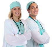 Doktorscy drużynowi potomstwa fabrykują portreta zajęcia pracy uśmiechniętego isolat Zdjęcie Royalty Free