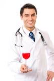 doktorsexponeringsglasrött vin arkivfoton