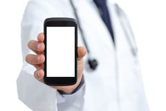 Doktorshand som visar en tom smart telefonskärm app Arkivbilder