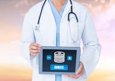 Doktorska mienie pastylka z pieniądze daruje guzika i ikonę dla dobroczynności Obrazy Stock