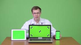 Doktorska obsiadania, seansu Chroma klucza zieleni ekranu laptopu Cyfrowego pastylka I zbiory