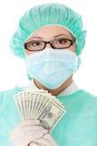 doktorski żeński mienia pieniądze chirurg Fotografia Stock