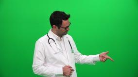 Doktorski wskazuje palec do lewego kąta zbiory wideo