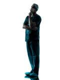 Doktorskirurgman med silhouetten för framsidamaskering Royaltyfri Bild