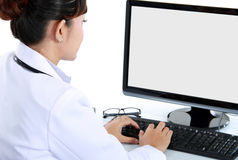 doktorsläkarundersökningworking Arkivbild