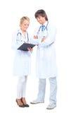 doktorssjuksköterskaworking Fotografering för Bildbyråer