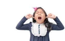 Dokuczający dzieciaka klejenie dotyka w ucho z oczami zamykającymi zdjęcie stock